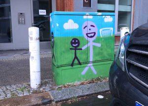 lachende Graffitimännchen auf einem Stromkasten